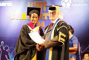 Vice-Chancellor, Professor Antony Chapman, handing out a certificate to a Cardiff Met graduate at ICBT